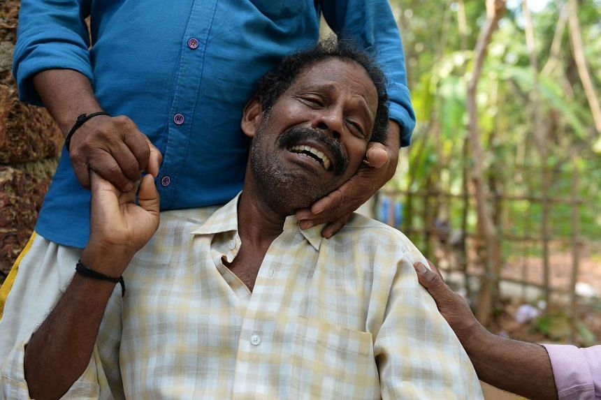 Ganesh P, father of 20-year-old Vishal, who died in the Puttingal temple fire tragedy, is consoled by a relative as he cries at his residence a day after his son's cremation, in Paravur, some 60kms north-west of Thiruvananthapuram on April 11, 2016.