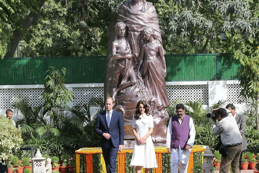 Britain's Prince William and his wife Catherine walk back after looking at a sculpture of Mahatma Gandhi during their visit to Gandhi Smriti in New Delhi on April 11, 2016. They arrived in the Indian capital on Monday from Mumbai.