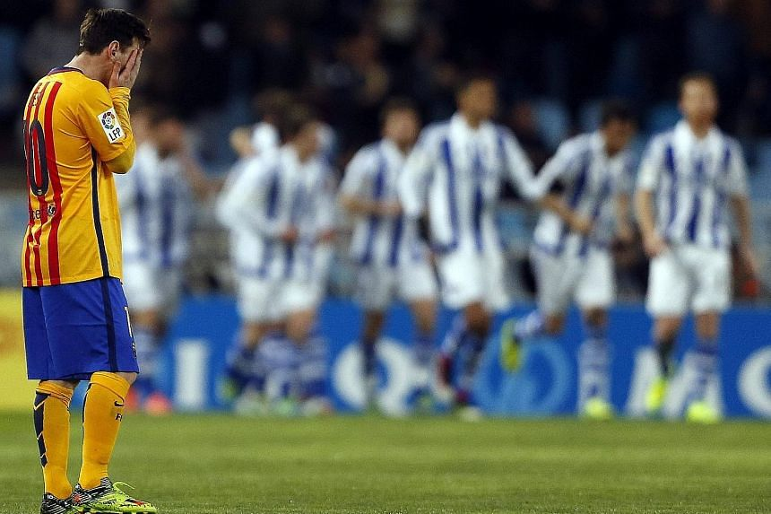 Real Sociedad is turning out to be Barcelona's jinx team after the Spanish and European champions lost away at San Sebastian for the fourth straight season, causing Lionel Messi (left) much despair.