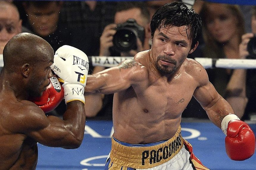 Manny Pacquiao landing a punch against Timothy Bradley in the fifth round, in which he unleashed a series of combinations to score heavily. The Filipino looked fresh and in great form despite an 11-month break, knocking down the American twice on his