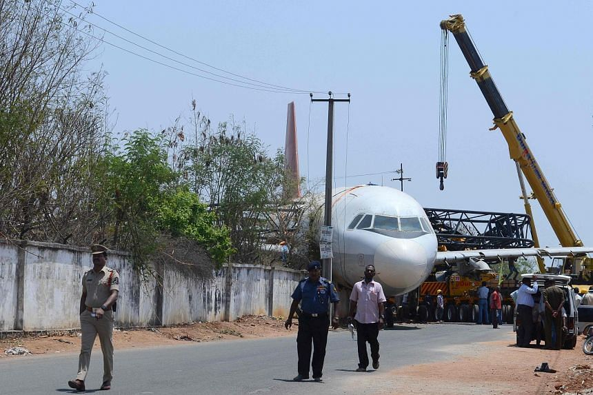 A disused Air India passenger plane fell from a ground transporter while being moved near Begumpet Airport in the Indian city of Hyderabad yesterday. The Airbus A-320 was being moved from the airport to Air India's cadet training facility when the tr