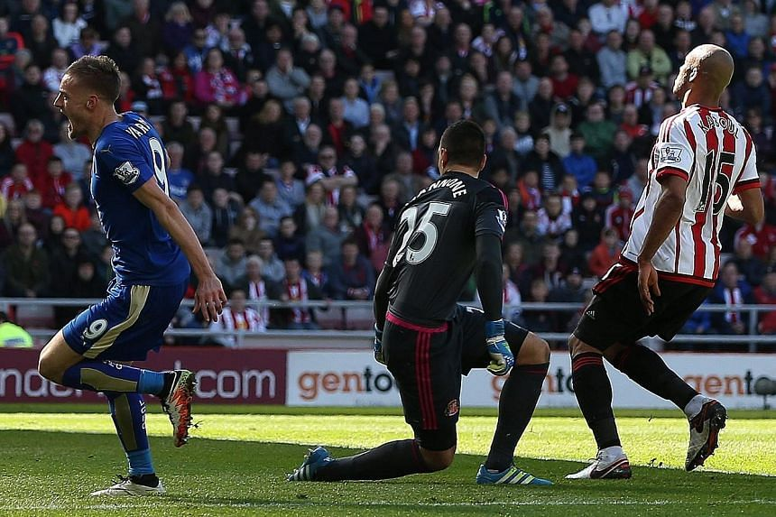 Leicester City's Jamie Vardy (far left) celebrating after scoring the opening goal during the league match against Sunderland at the Stadium of Light