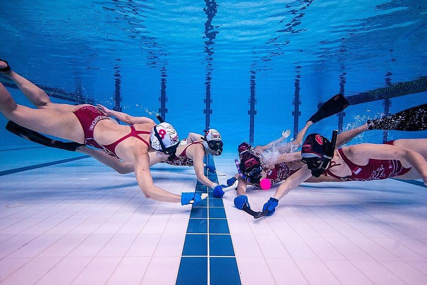 The national women's team tussling for the puck in training. They finished a respectable 11th out of 13 teams at the Underwater Hockey World Championships last month.