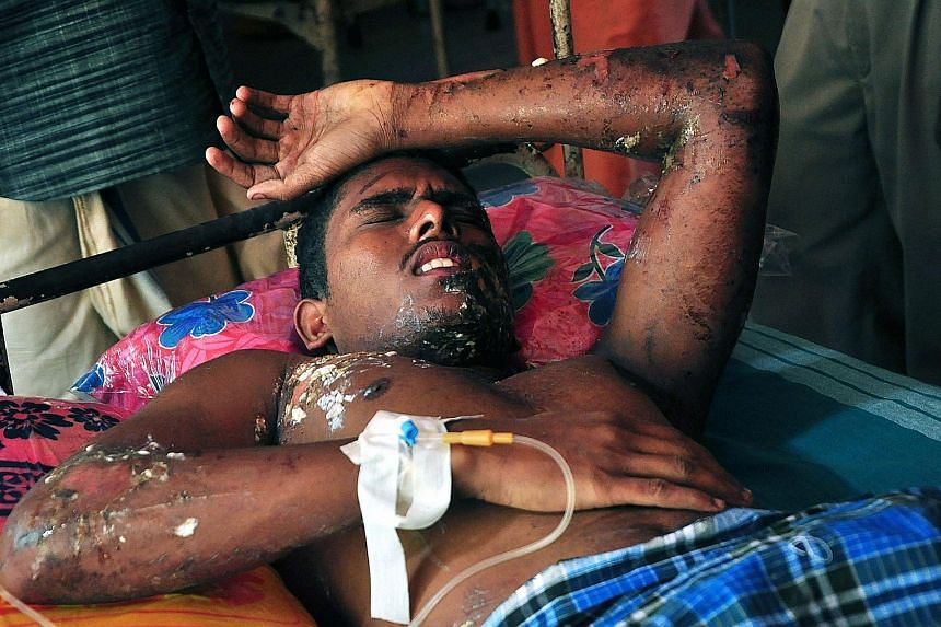 A survivor being treated in a hospital. The chief doctor at Thiruvananthapuram Medical College said some of those pouring into the hospital had suffered serious injuries. Most of the casualties from the Puttingal Temple fire occurred when the massive