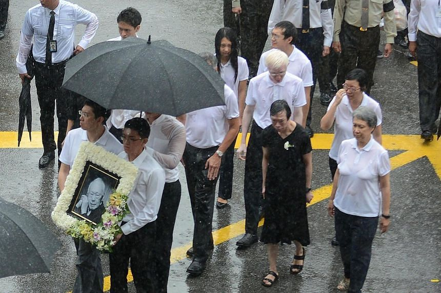 Dr Lee Wei Ling (wearing black), the younger sister of Prime Minister Lee Hsien Loong, walking alongside family members at Mr Lee Kuan Yew's funeral in March last year.
