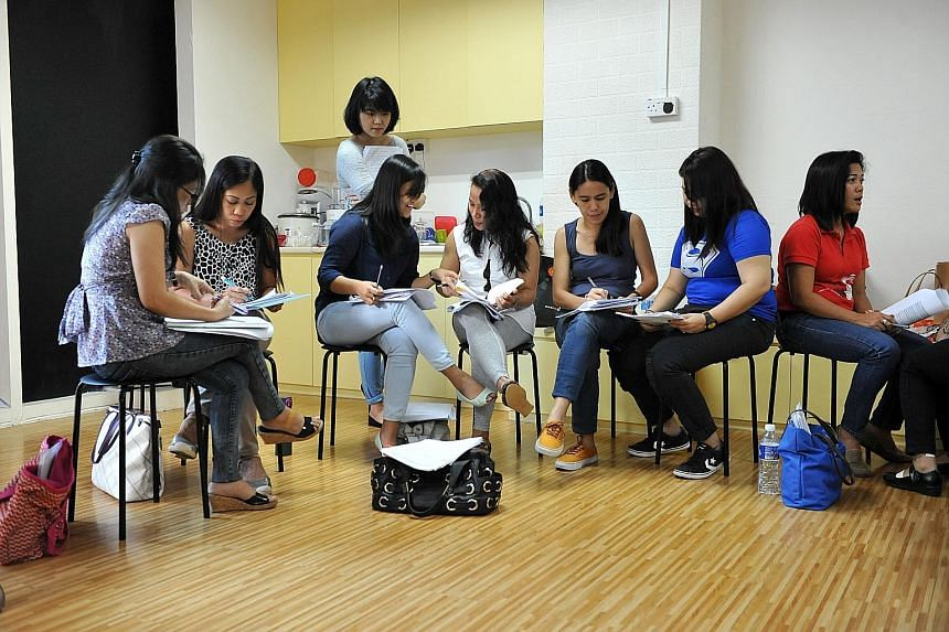 Participants role-playing as counsellors while research assistant Suzhen Zheng looks on. (Above) Ms Robina Lavato signed up to learn more about how to help her peers.
