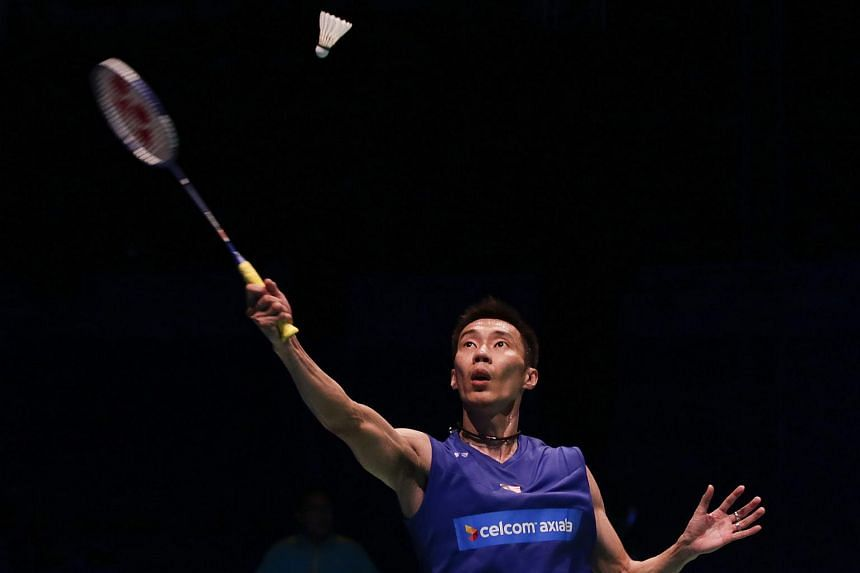 Lee Chong Wei of Malaysia in action against Cheng Long (not pictured) of China during their men's single final match of Celcom-Axiata Malaysia Open Badminton tournament.