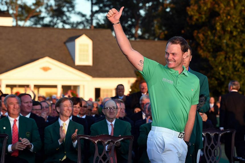 Danny Willett of England celebrates winning the 2016 Masters Tournament, on April 10, 2016.