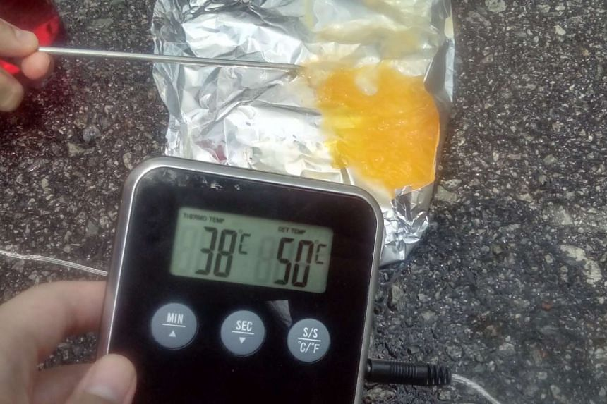 The egg on the asphalt climbed to a high of 38 deg C at 3pm, when measured with a food thermometer, and the yolk had visibly hardened.