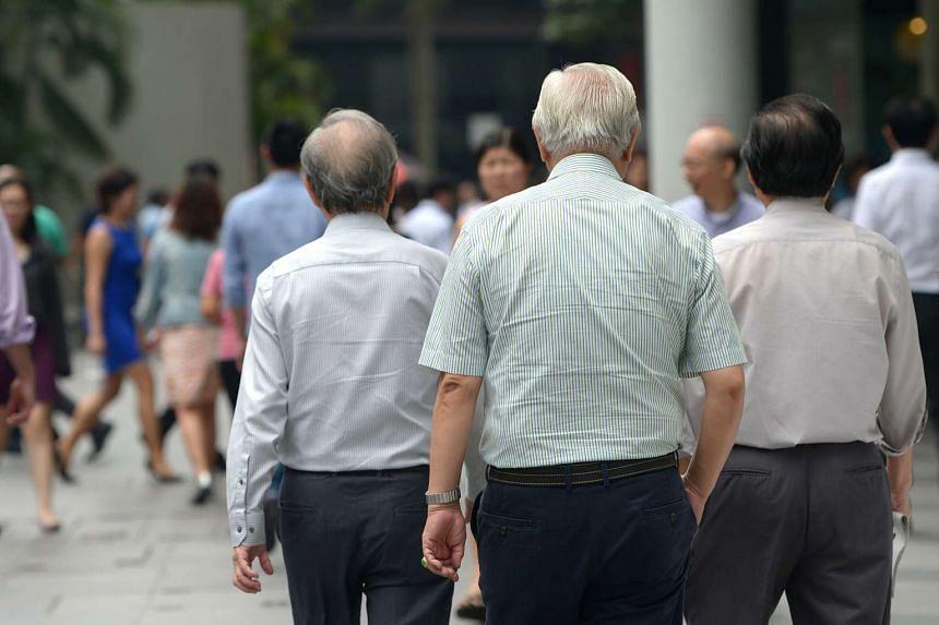 Elderly men at Raffles Place.