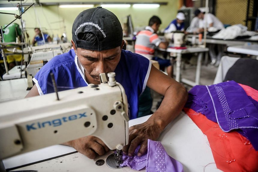 An inmate sewing as part of the social project Pieta, led by French designer Thomas Jacob.