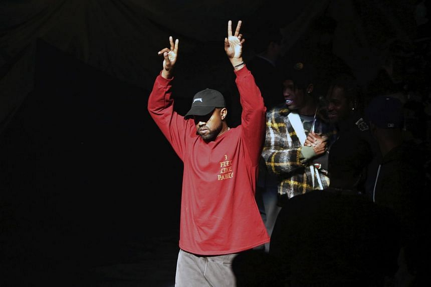 Kanye West acknowledges attendees before his Yeezy Season 3 Collection presentation and listening party for the The Life of Pablo album during New York Fashion Week on Feb 11, 2016.
