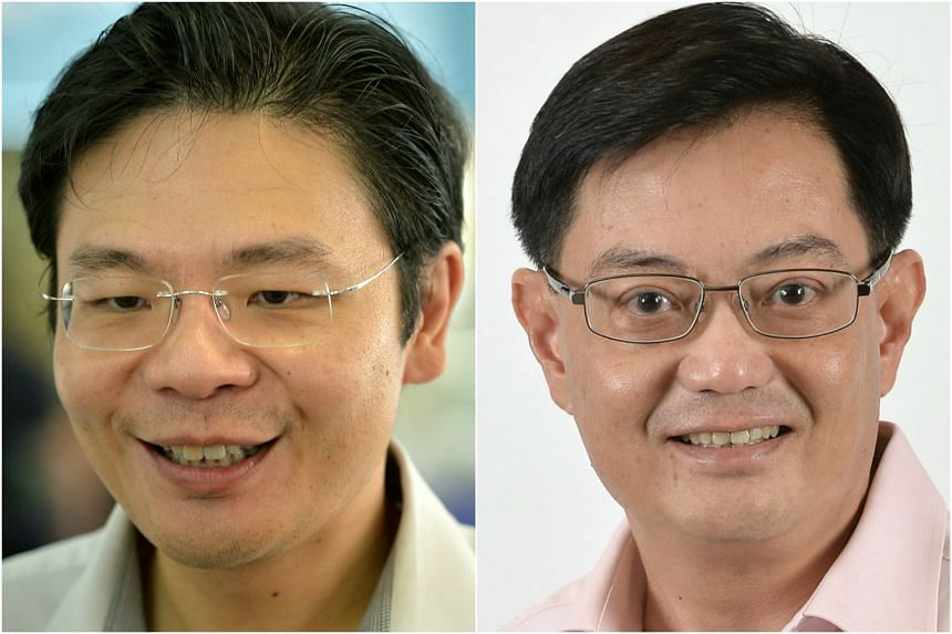 Minister for National Development Lawrence Wong (left) and Finance Minister Heng Swee Keat.