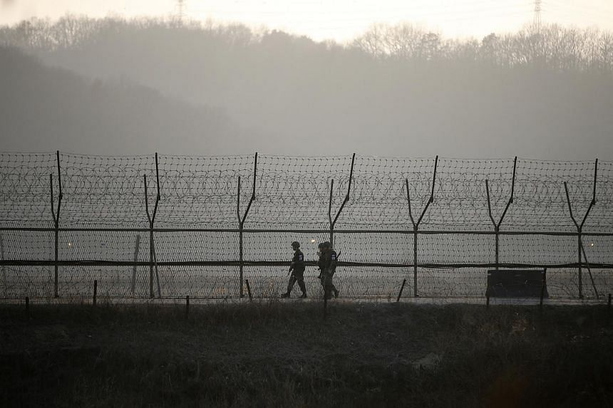 South Korean soldiers on patrol near the demilitarised zone separating the two Koreas in Paju on March 21, 2016.