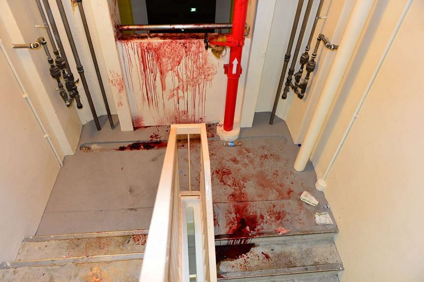 The bloodstained area in a Tampines block where Zheng Xianghua stabbed and slashed himself after he killed his wife.