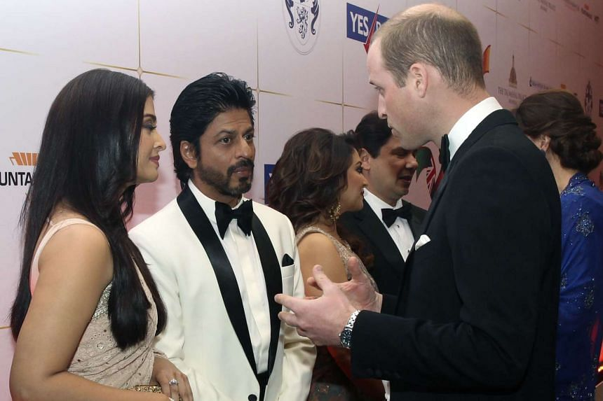 Prince William speaks with Bollywood actors Shahrukh Khan and Aishwarya Rai at a reception at the Taj hotel in Mumbai on Sunday.