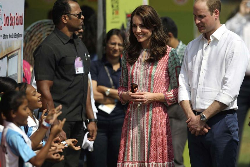 Britain's Prince William and Kate meet with Indian children who are beneficiaries of NGOs at the Oval Maidan in Mumbai on Sunday.