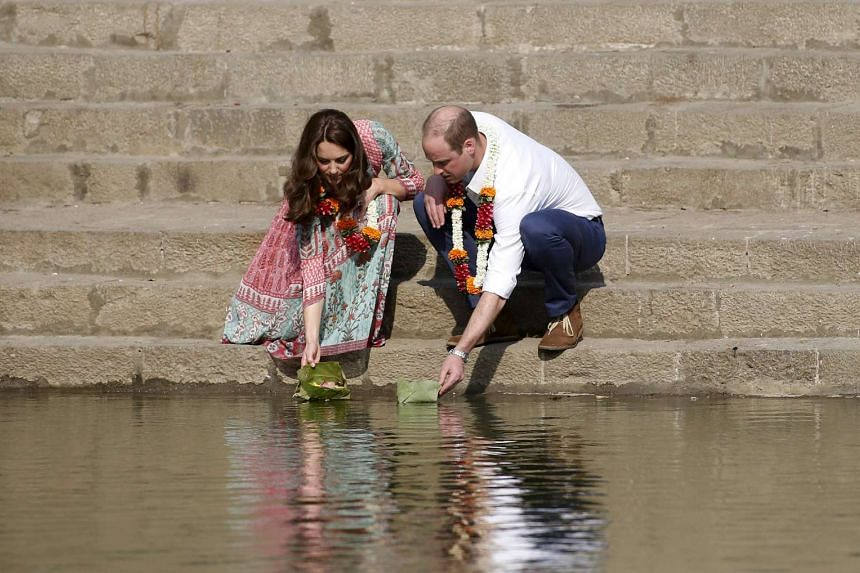 Britain's Prince William and Kate visit the historic Banganga water tank in Mumbai on Sunday.