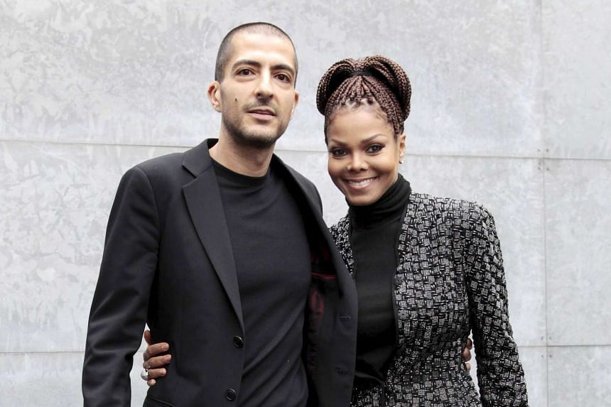 US singer Janet Jackson (R) and her then boyfriend Wissam Al Mana pose at the at Milan Fashion Week in 2013.