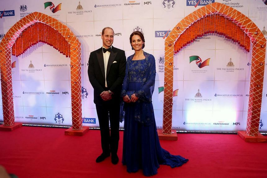 Britain's Prince William and his wife Catherine, Duchess of Cambridge, pose for photographs at a charity gala function at the Taj Mahal Palace hotel in Mumbai on Sunday.