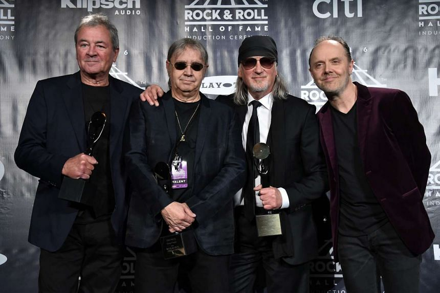From left to right, Ian Gillan, Ian Paice, and Roger Glover of Deep Purple pose with Lars Ulrich of Metallica at the 31st Annual Rock And Roll Hall Of Fame Induction Ceremony  in New York City.