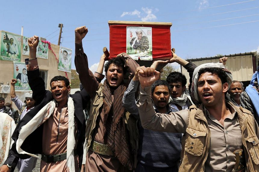 Houthi supporters carry the coffin of a militia member allegedly killed in recent fighting with Saudi-backed Yemeni forces ahead of a UN-announced ceasefire, on April 10, 2016.