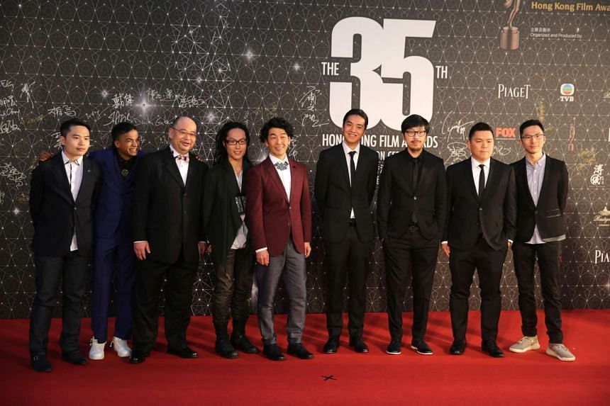 Cast and crew from the controversial Hong Kong film Ten Years, pose for a photo on the red carpet at the Hong Kong Film Awards.