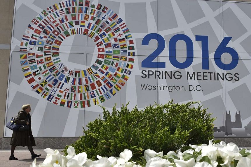 A sign announcing the 2016 spring meetings of the International Monetary Fund and World Bank outside the IMF headquarters on April 10, 2016.