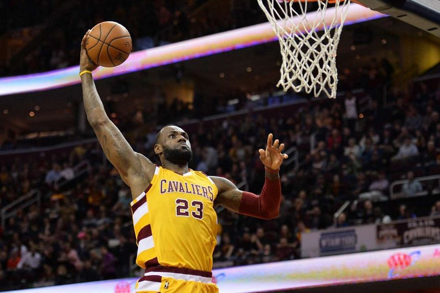 Cleveland Cavaliers forward LeBron James slam dunks against the Atlanta Hawks during the first quarter at Quicken Loans Arena.