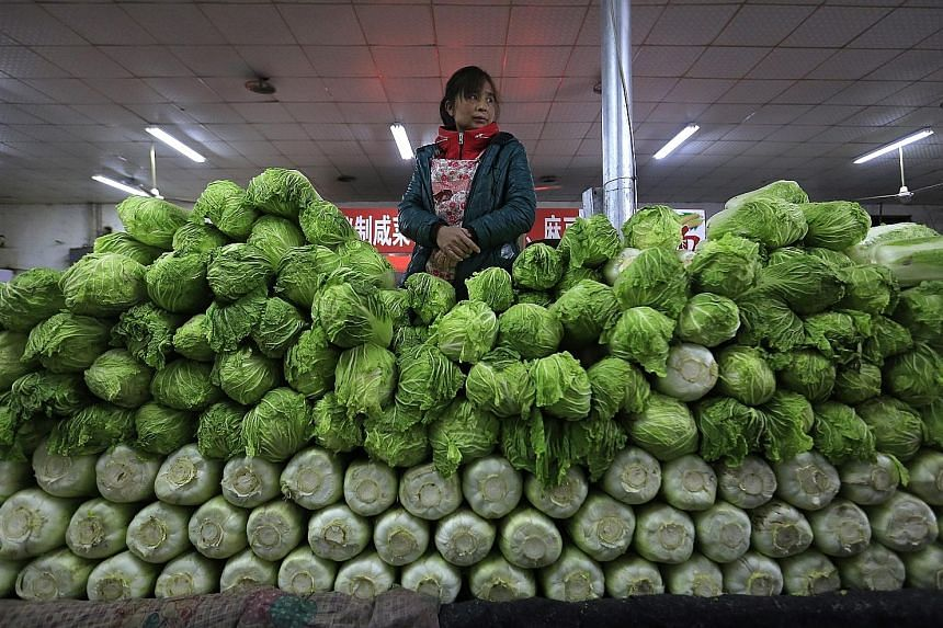 Vegetables being sold at a market in Beijing. China's consumer prices remain strong in March, driven mainly by rising vegetable and pork prices.