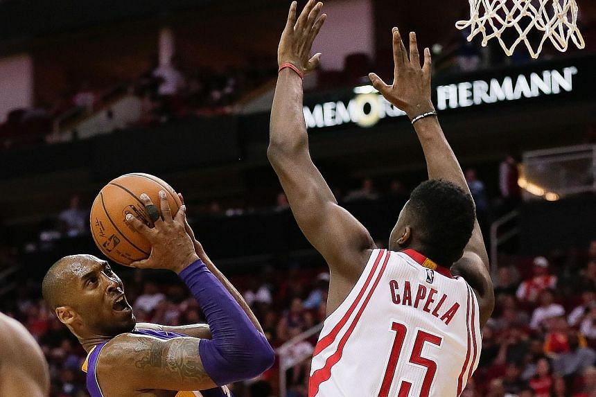 The Lakers' Kobe Bryant (left), guarded by Houston's Clint Capela, said he was not surprised by his form in the 110-130 loss.