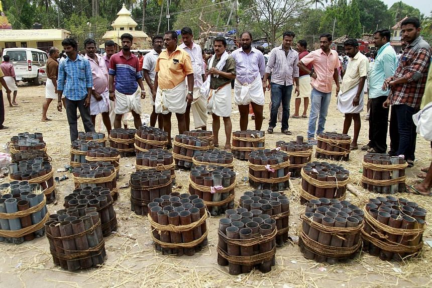 Empty firecracker shells inside the Puttingal Temple compound in the Kollam district of Kerala on Sunday. Witnesses described mass panic after Sunday's explosion, which left more than 100 people dead. The blast is thought to have been sparked by a fi