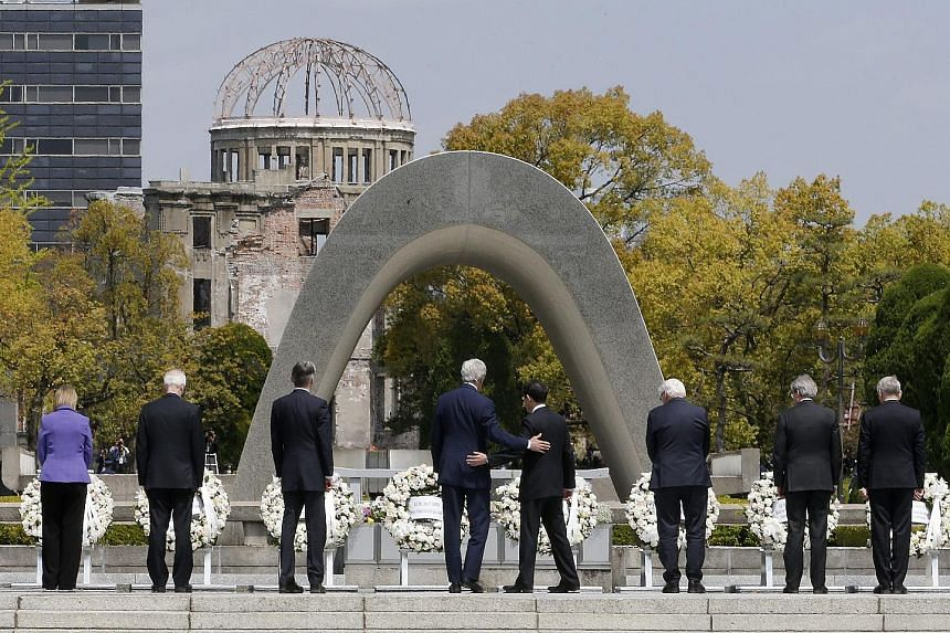 Mr Kerry (fourth from left) with his Japanese counterpart Fumio Kishida (fifth from left) and other G-7 foreign ministers at a wreath-laying ceremony for Hiroshima atomic bombing victims at the memorial park.