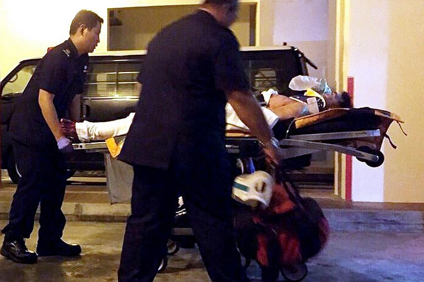 Zheng Xianghua (left, being wheeled away to hospital after the tragedy) stabbed himself in the chest and slashed his neck after killing Madam Wang Xueyan (above) in his rented room in Tampines in December 2014.