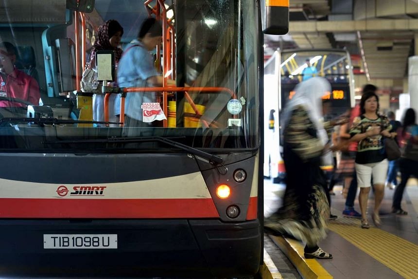 Commuters alight from an SMRT bus at the Woodlands Regional Bus Interchange.