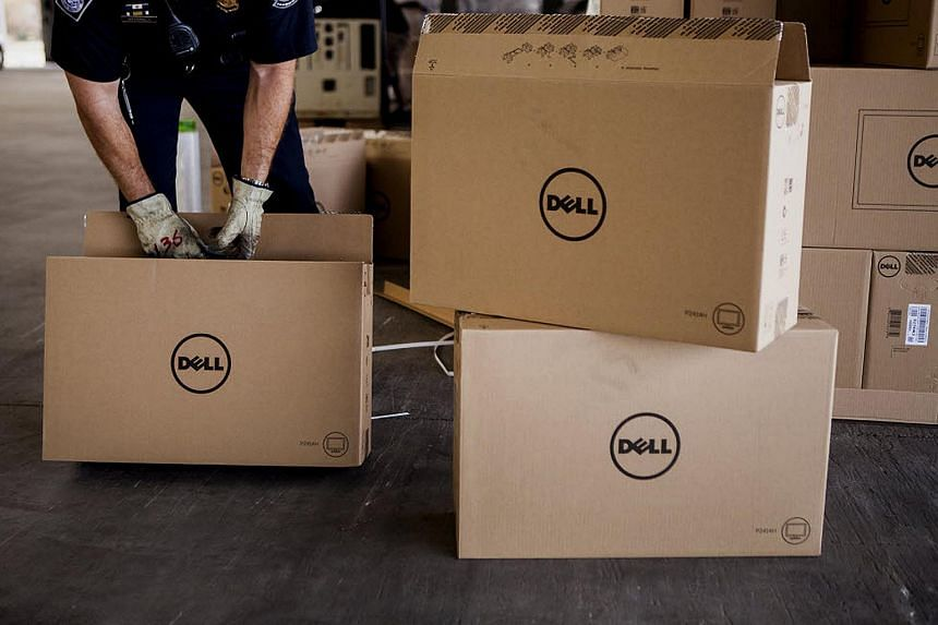 A US Customs and Border Protection officer inspects boxes of Dell Inc. computer monitors at the Calexico East Port of Entry in California.