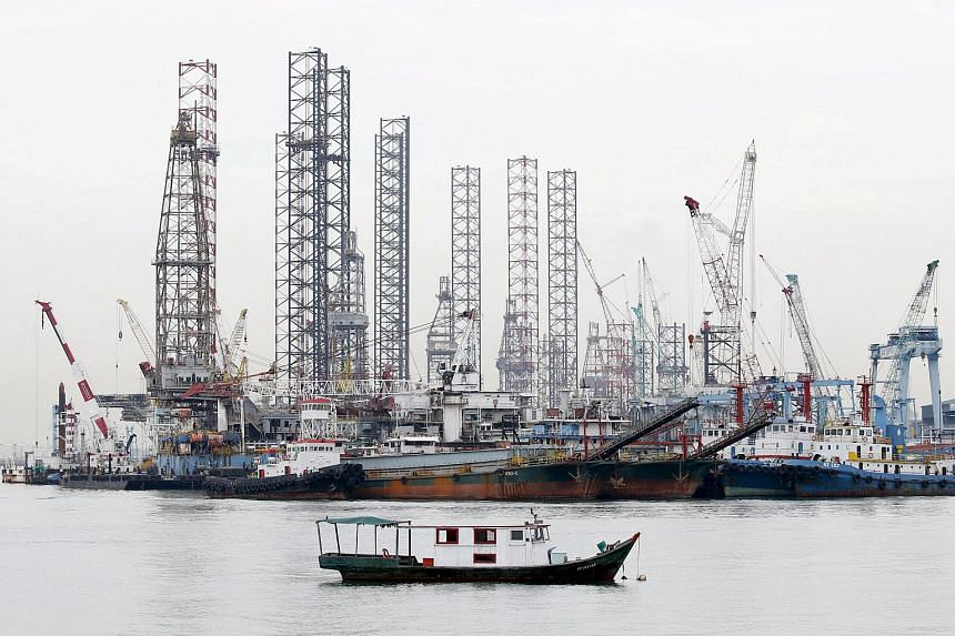 Offshore drilling platforms at a dockyard near Singapore's port.