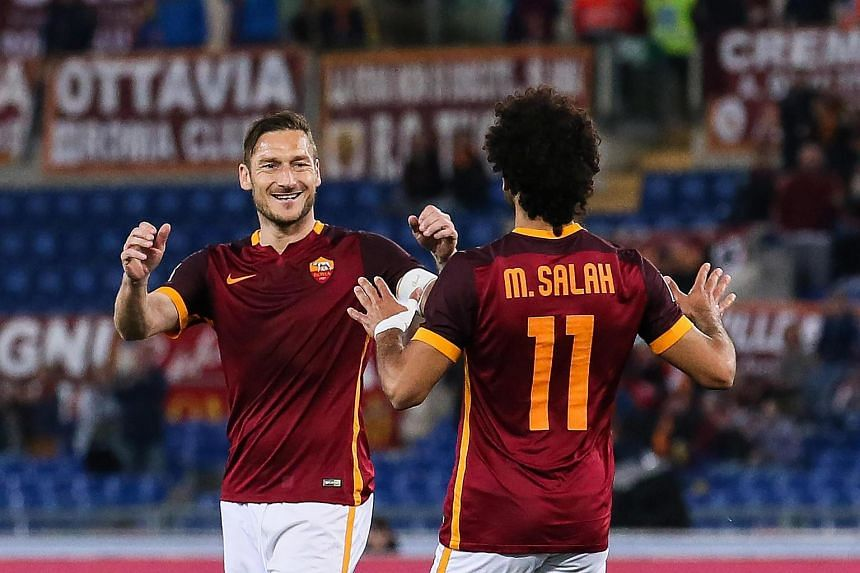 Roma's Mohamed Salah (right) celebrates scoring the 1-1 equaliser goal with Francesco Totti during the Italian Serie A football match between AS Roma and FC Bologna.