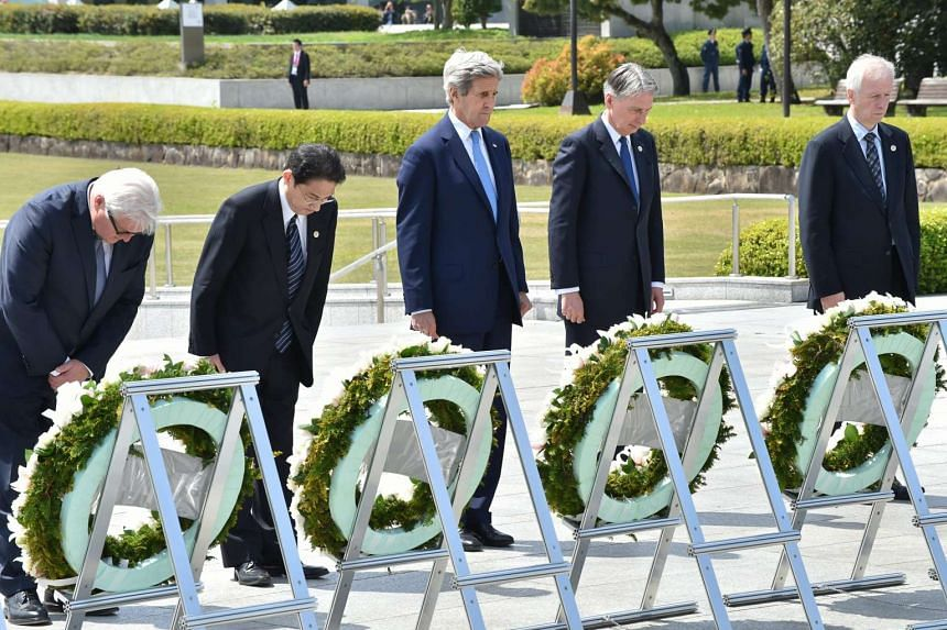 Foreign ministers offer a silent prayer at the Memorial Cenotaph in Hiroshima on the sidelines of the G-7 Foreign Ministers' Meeting on April 11, 2016.