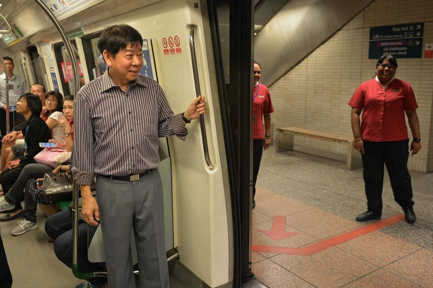 Transport Minister Khaw Boon Wan (left) travelling from Tiong Bahru to Bouna Vista stations while observing an MRT ground deployment exercise on Oct 14, 2015.