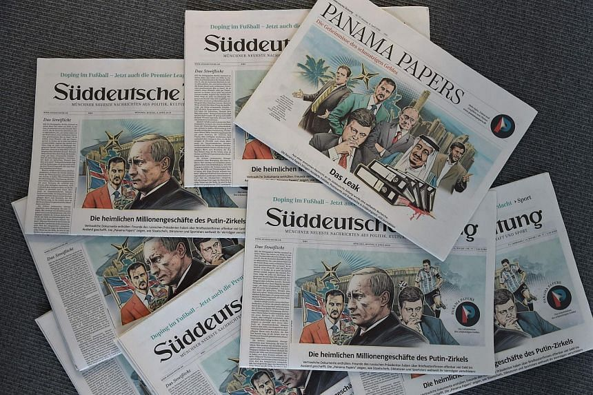 Copies of the German daily Sueddeutsche Zeitung dated April 4, 2016, with Panama Papers news in the headlines.