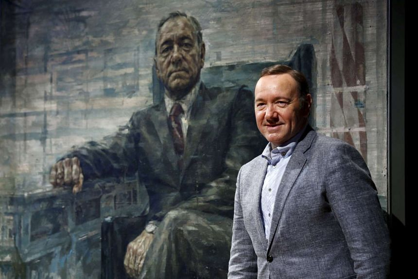 Actor Kevin Spacey stands beside a portrait of his House of Cards character President Frank J. Underwood at the Smithsonian's National Portrait Gallery in Washington.