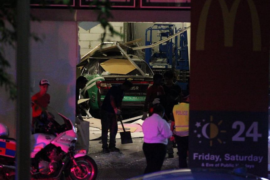 An SMRT taxi crashed into a Bugis+ shop unit that was under renovation, injuring one worker on April 11, 2016.