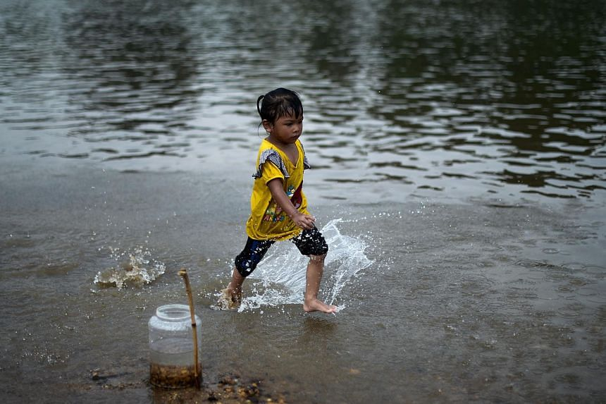 A child plays in a river in Termerloh, outside Kuala Lumpur.