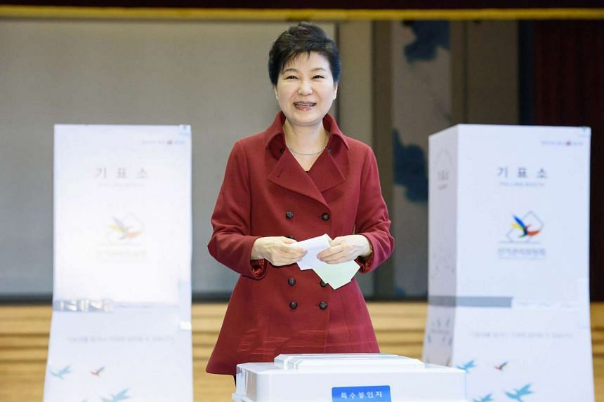 South Korean President Park Geun Hye casting her vote for the parliamentary elections at a polling station in Seoul on April 13, 2016.