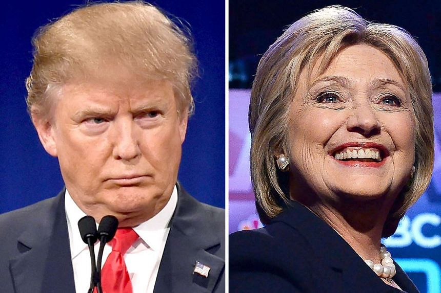 This file photo taken on March 2, 2016 shows a combination of file photos of Republican presidential hopeful Donald Trump on Jan 14, 2016 and his Democratic rival Hillary Clinton on Feb 4, 2016.