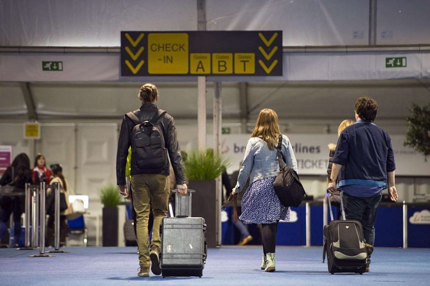 Passengers arrive at provisional check-in counters at Brussels Airport in Zaventem, near Brussels, Belgium, on April 4, 2016.