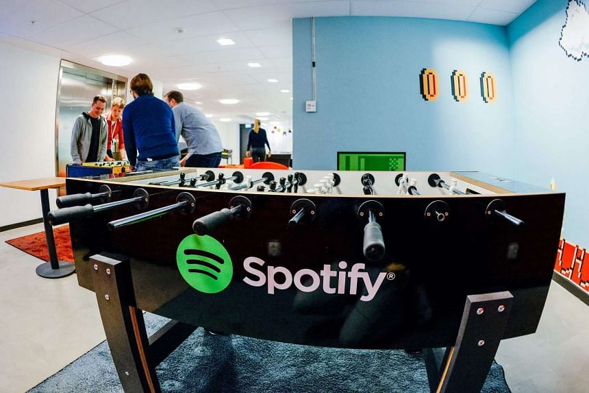 The rapid growth of streaming services such as Spotify led digital music to surpass sagging physical sales for the first time last year.