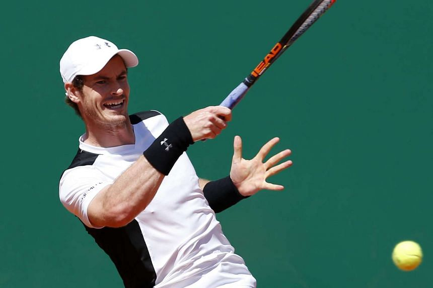 Andy Murray of Great Britain returns the ball to Pierre Hugues Herbert of France during their second round match at the Monte-Carlo Rolex Masters tennis tournament in Roquebrune Cap Martin, France, on April 12, 2016.