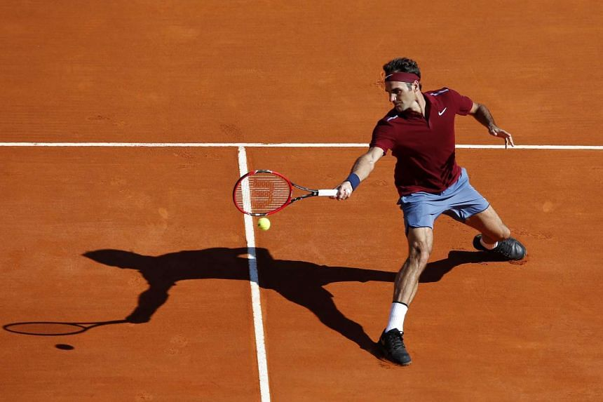 Roger Federer of Switzerland returns the ball to Guillermo Garcia Lopez of Spain during their second round match at the Monte-Carlo Rolex Masters tennis tournament in Roquebrune Cap Martin, France, on April 12, 2016.